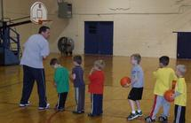 Children participating in a basketball clinic