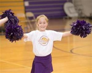 A girl participating in a cheerleading clinic